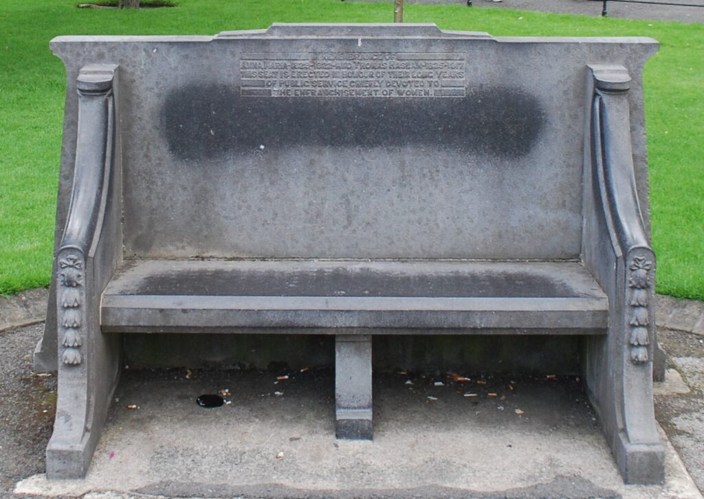 Ornate stone seat in St Stephen's Green commemorating Anna and Thomas Haslam for their dedication to the cause of women's suffrage.
