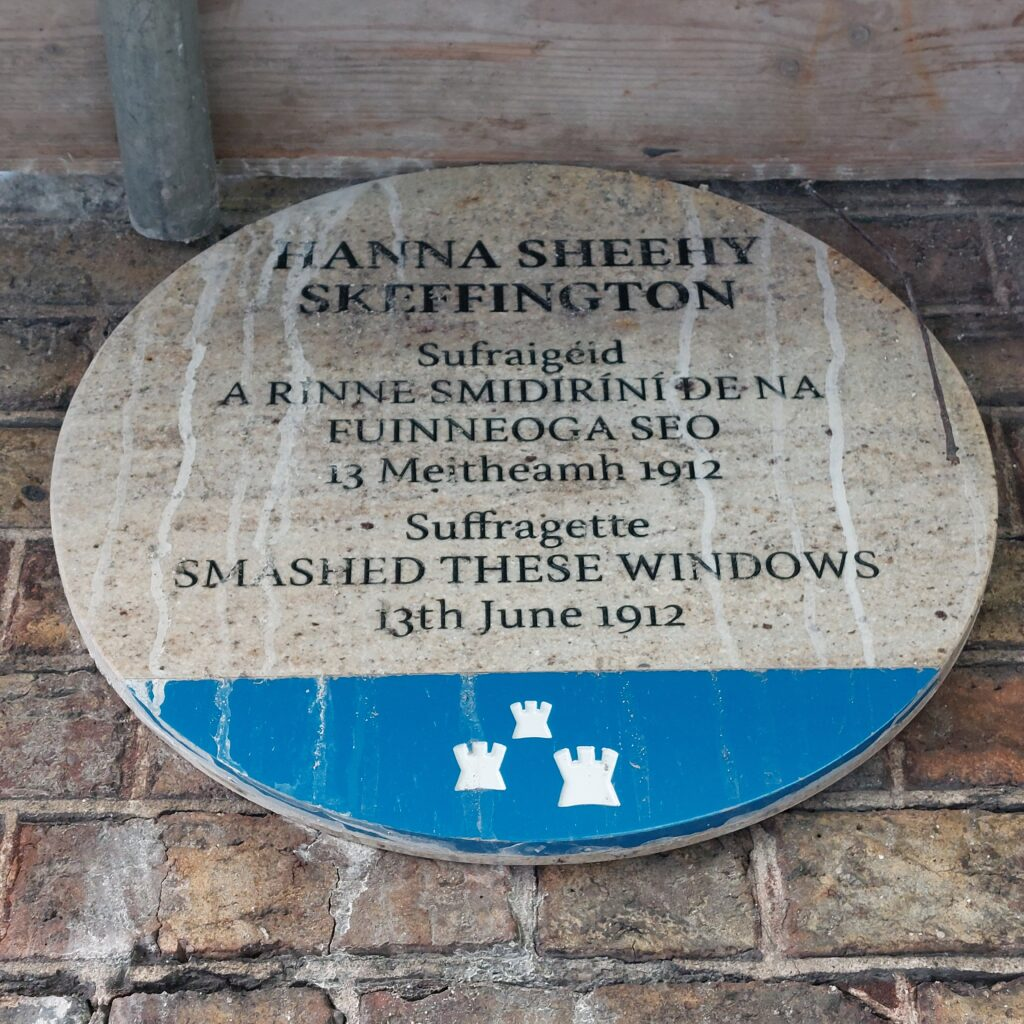 Blue plaque commemorating where suffragette Hanna Sheehy Skeffington smashed windows at Dublin Castle in 1912